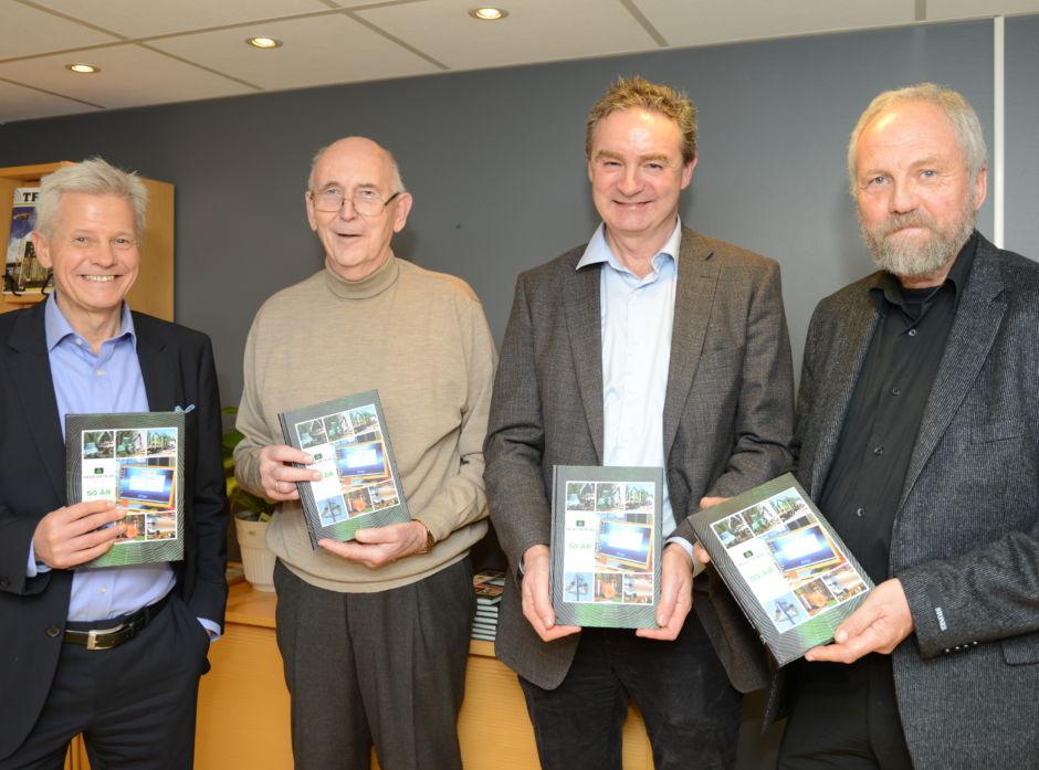 Bildet: Børge Teigland, styreleder; Bertil Akselsen, daglig leder i 30 år (1968-1998); Svend Bøhler, daglig leder og Anders Hals, forfatter av jubileumsboka fra selskapets 50-års-markering den 8. desember 2016.